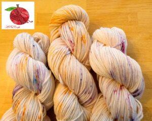 speckled orange, pink, purple, and blue mcn yarn